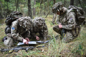 Pictured are members of C Squadron from the Queen's Royal Hussars checking their position on a map during a Junior NCO Cadre.